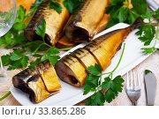 Sliced smoked mackerel with parsley. Стоковое фото, фотограф Яков Филимонов / Фотобанк Лори