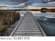 Купить «Crimson Lake Alberta Canada boat dock sunset», фото № 33867010, снято 11 июля 2020 г. (c) age Fotostock / Фотобанк Лори
