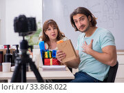 Young couple sales consultants recording video for their blog. Стоковое фото, фотограф Elnur / Фотобанк Лори