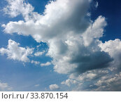 Купить «Beautiful clouds against a blue sky background. Cloud sky. Blue sky with clouds weather, nature cloud. White clouds, blue sky and sun», фото № 33870154, снято 31 мая 2020 г. (c) easy Fotostock / Фотобанк Лори