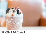 Купить «Frappuchino chocolate with cookie and cream», фото № 33871294, снято 30 мая 2020 г. (c) easy Fotostock / Фотобанк Лори
