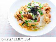Купить «Japanese traditional food, Tonkatsu deep-fried pork cutlet on top with eggs», фото № 33871354, снято 31 мая 2020 г. (c) easy Fotostock / Фотобанк Лори