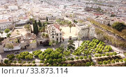 Купить «Aerial view of Catholic Cathedral and famous Alcazar of Jerez de la Frontera, Spain», видеоролик № 33873114, снято 19 апреля 2019 г. (c) Яков Филимонов / Фотобанк Лори
