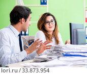 Купить «Two colleagues working in the office», фото № 33873954, снято 11 июня 2018 г. (c) Elnur / Фотобанк Лори