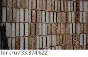 Купить «Closeup of empty slatted wooden crates stacked in pile», видеоролик № 33874622, снято 27 апреля 2020 г. (c) Яков Филимонов / Фотобанк Лори