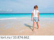Купить «Adorable little girl have fun at tropical beach during vacation», фото № 33874662, снято 12 апреля 2014 г. (c) Дмитрий Травников / Фотобанк Лори