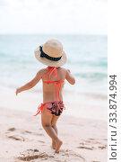 Купить «Adorable little girl have fun at tropical beach during vacation», фото № 33874994, снято 22 апреля 2012 г. (c) Дмитрий Травников / Фотобанк Лори