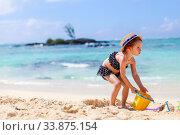 Купить «Adorable little girl have fun at tropical beach during vacation», фото № 33875154, снято 20 апреля 2012 г. (c) Дмитрий Травников / Фотобанк Лори