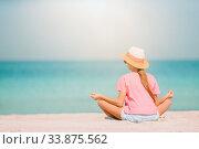 Купить «Adorable little girl have fun at tropical beach during vacation», фото № 33875562, снято 20 февраля 2020 г. (c) Дмитрий Травников / Фотобанк Лори
