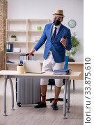 Купить «Businessman preparing for trip during pandemic», фото № 33875610, снято 7 мая 2020 г. (c) Elnur / Фотобанк Лори