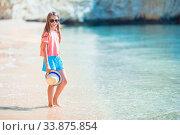 Купить «Adorable little girl have fun at tropical beach during vacation», фото № 33875854, снято 19 июня 2019 г. (c) Дмитрий Травников / Фотобанк Лори