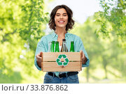 Купить «smiling young woman sorting glass waste», фото № 33876862, снято 18 апреля 2020 г. (c) Syda Productions / Фотобанк Лори