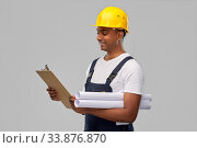 happy indian builder with blueprint and clipboard. Стоковое фото, фотограф Syda Productions / Фотобанк Лори