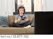 Купить «boy with gamepad playing video game at home», фото № 33877102, снято 10 апреля 2020 г. (c) Syda Productions / Фотобанк Лори