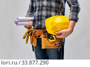 builder with helmet, blueprint and working tools. Стоковое фото, фотограф Syda Productions / Фотобанк Лори