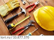 Купить «different work tools on wooden boards», фото № 33877370, снято 26 ноября 2019 г. (c) Syda Productions / Фотобанк Лори