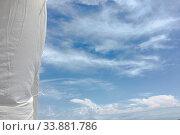 Купить «Beautiful clouds against a blue sky background. Cloud sky. Blue sky with clouds weather, nature cloud. White clouds, blue sky and sun», фото № 33881786, снято 2 июня 2020 г. (c) easy Fotostock / Фотобанк Лори