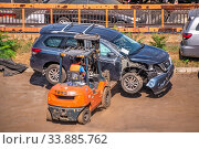 Купить «Broken cars for export in the Cargo Port of Odessa, Ukraine», фото № 33885762, снято 16 сентября 2019 г. (c) Sergii Zarev / Фотобанк Лори