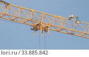 Crane at the construction site. Close-up. Стоковое видео, видеограф Mikhail Erguine / Фотобанк Лори