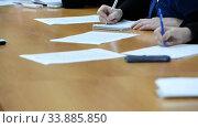 Купить «Hands of an official, businessman serving on the table. Meeting», видеоролик № 33885850, снято 29 мая 2020 г. (c) Mikhail Erguine / Фотобанк Лори