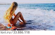 Купить «Beach vacation of girl sitting on sand beach in sea», видеоролик № 33886118, снято 25 мая 2020 г. (c) Gennadiy Poznyakov / Фотобанк Лори