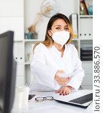 Hispanic female doctor working with patient. Стоковое фото, фотограф Яков Филимонов / Фотобанк Лори
