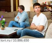 Купить «Offended teenager after disagreements with father», фото № 33886650, снято 4 июня 2020 г. (c) Яков Филимонов / Фотобанк Лори