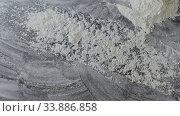 Купить «Sharp throw of fresh natural flour on a dark table. Slow motion, Full HD video, 240fps, 1080p. Process preparing of bake.», видеоролик № 33886858, снято 31 мая 2020 г. (c) Ярослав Данильченко / Фотобанк Лори