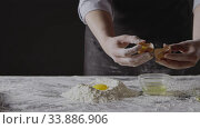 Step by step homemade dough preparation. Woman's hands separete the second yolk from white and put into flour. Slow motion, Full HD video, 240fps, 1080p. Стоковое видео, видеограф Ярослав Данильченко / Фотобанк Лори