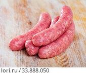 Raw sausages for frying. Стоковое фото, фотограф Яков Филимонов / Фотобанк Лори
