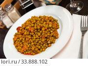 Купить «Plate of stewed beans with ham on table», фото № 33888102, снято 3 июня 2020 г. (c) Яков Филимонов / Фотобанк Лори