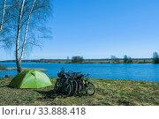 Купить «Bicycles and a light green tent on the shore of the Uvodsky reservoir», фото № 33888418, снято 2 мая 2020 г. (c) Валерий Смирнов / Фотобанк Лори