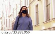 Купить «woman in protective mask with travel bag in city», видеоролик № 33888950, снято 25 мая 2020 г. (c) Syda Productions / Фотобанк Лори