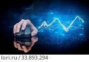 Купить «Hand using wireless mouse with statistical concept on dark background», фото № 33893294, снято 5 августа 2020 г. (c) easy Fotostock / Фотобанк Лори
