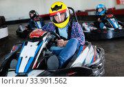 Купить «Portrait of male racer in helmet driving kart on track», фото № 33901562, снято 5 июля 2020 г. (c) Яков Филимонов / Фотобанк Лори