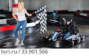 Купить «Male racer crossing finish line on kart track», фото № 33901566, снято 5 июля 2020 г. (c) Яков Филимонов / Фотобанк Лори