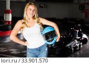 Купить «Woman standing near go-kart cars», фото № 33901570, снято 1 июля 2020 г. (c) Яков Филимонов / Фотобанк Лори
