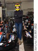 female go-cart racer posing at cart circuit. Стоковое фото, фотограф Яков Филимонов / Фотобанк Лори