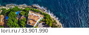 Panoramic view directly from above coast and Mediterranean Sea. Summer luxury villas with swimming pools, parking area, sport tennis field. Mallorca or Majorca Island, Balearic Islands, España, Spain (2018 год). Стоковое фото, фотограф Alexander Tihonovs / Фотобанк Лори