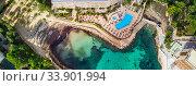 Aerial panoramic photo coast of Cala Vinyes, green transparent water bay of Mediterranean Sea. Majorca, Espana, Spain (2018 год). Стоковое фото, фотограф Alexander Tihonovs / Фотобанк Лори