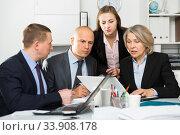 Купить «Business team working at office», фото № 33908178, снято 14 января 2019 г. (c) Яков Филимонов / Фотобанк Лори