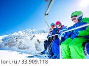 Купить «Boy and group of happy children on ski chairlift», фото № 33909118, снято 12 февраля 2020 г. (c) Сергей Новиков / Фотобанк Лори