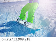 Купить «Snowboard close-up on snow of the boy in motion», фото № 33909218, снято 14 февраля 2020 г. (c) Сергей Новиков / Фотобанк Лори