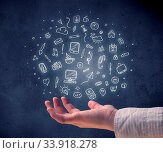 Купить «Mixed white media and communication related icons hovering above young hand», фото № 33918278, снято 4 июля 2020 г. (c) easy Fotostock / Фотобанк Лори
