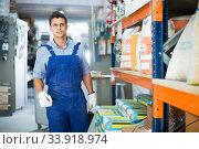 Купить «Young male in uniform on his workplace», фото № 33918974, снято 26 июля 2017 г. (c) Яков Филимонов / Фотобанк Лори