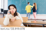 Купить «Portrait of unhappy female chinese student in auditorium», фото № 33919078, снято 9 марта 2020 г. (c) Яков Филимонов / Фотобанк Лори