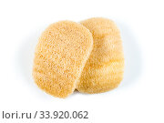Loofah sponge close up isolated on white. Luffa sponge, fiber scrubber, cleansing beauty product. Стоковое фото, фотограф Константин Лабунский / Фотобанк Лори