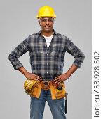 Купить «happy indian builder in helmet with tool belt», фото № 33928502, снято 17 ноября 2019 г. (c) Syda Productions / Фотобанк Лори