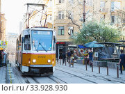 Sofia tramway network. Sofia is the capital and largest city of Bulgaria. Old tram on the Bulgarian streets (2018 год). Редакционное фото, фотограф Nataliia Zhekova / Фотобанк Лори