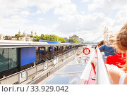 LONDON - AUGUST 19, 2017: City Cruises tour boat on River Thames. City view from the Thames river. Редакционное фото, фотограф Nataliia Zhekova / Фотобанк Лори